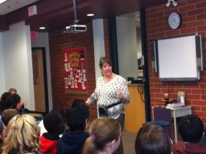 Talented storyteller Mary Hays holding her junior-high audience rapt