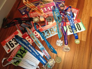 Some of my running logs, race bibs and bling from the past ten years.