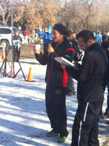 Justin at the microphone, greeting runners as they finish the race